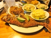 Fried snapper, potato salad, peas and grits, and cole slaw
