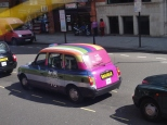 One of the many painted taxi cabs that dot the city's busy streets. This one features the Coach trademark.